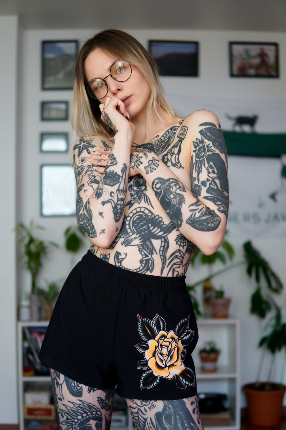 woman in black and white floral long sleeve shirt and black skirt