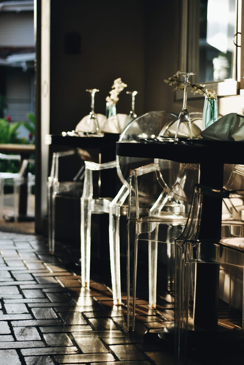 stainless steel bar stools near glass window