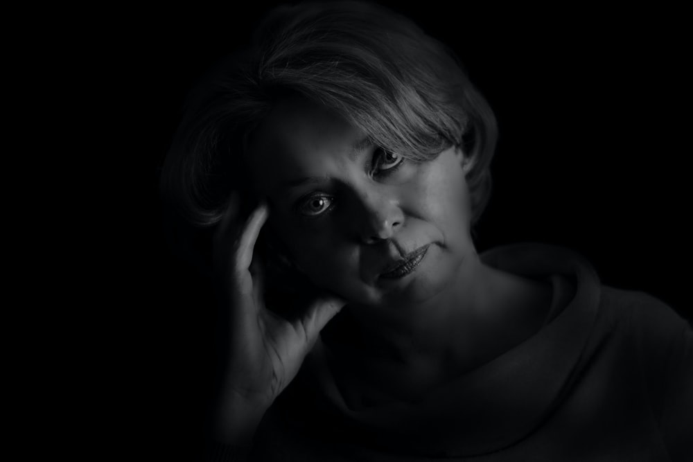 grayscale photo of woman with eyes closed