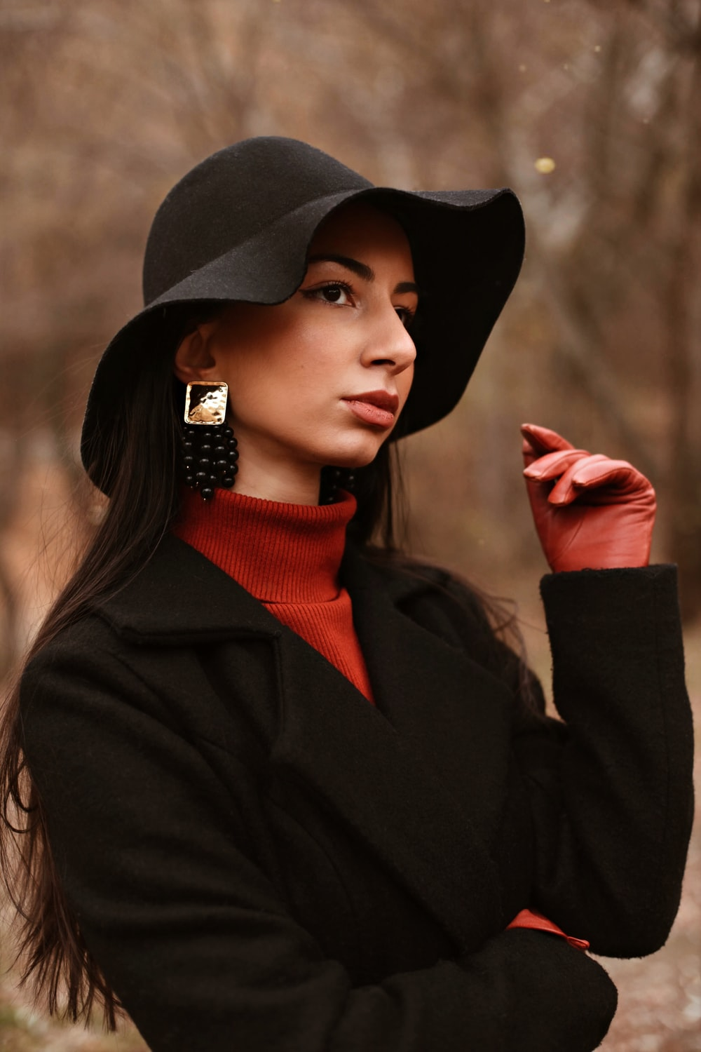 woman in black hat and black coat