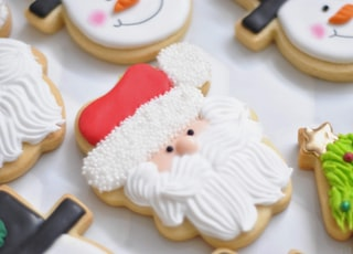 white snowman figurine beside red heart ornament