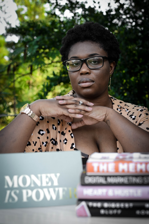 woman in black framed eyeglasses and brown leopard print shirt