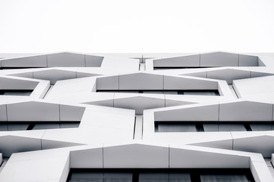 white concrete building during daytime archi-texture teams background