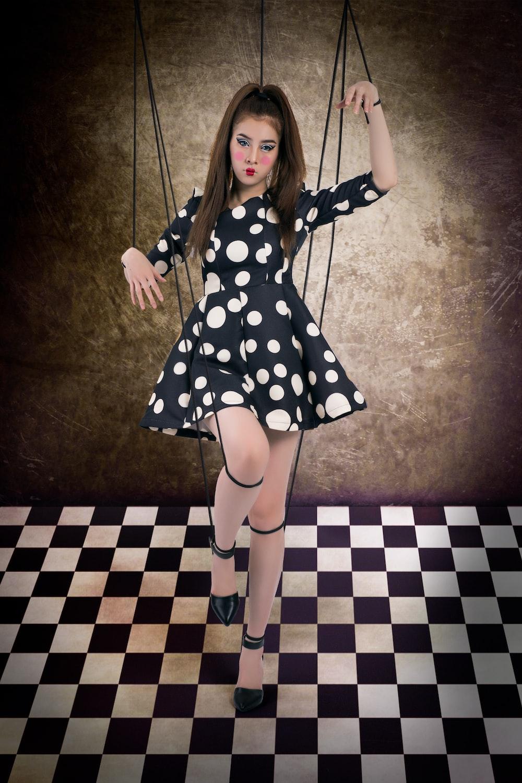 girl in black and white polka dot dress