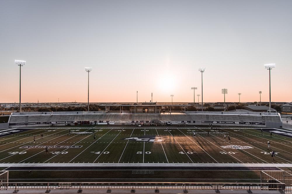 black and white stadium during sunset