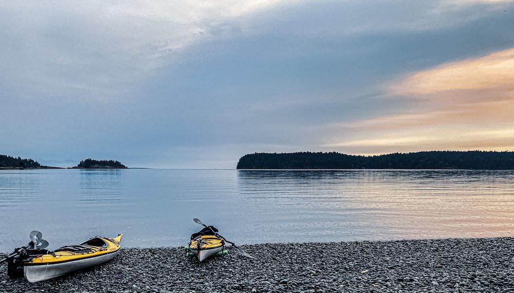 yellow kayak on body of water during daytime