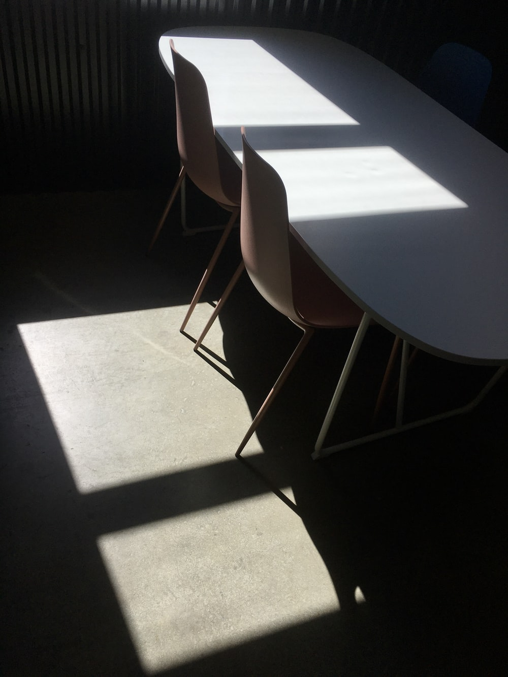brown and gray chair beside white table