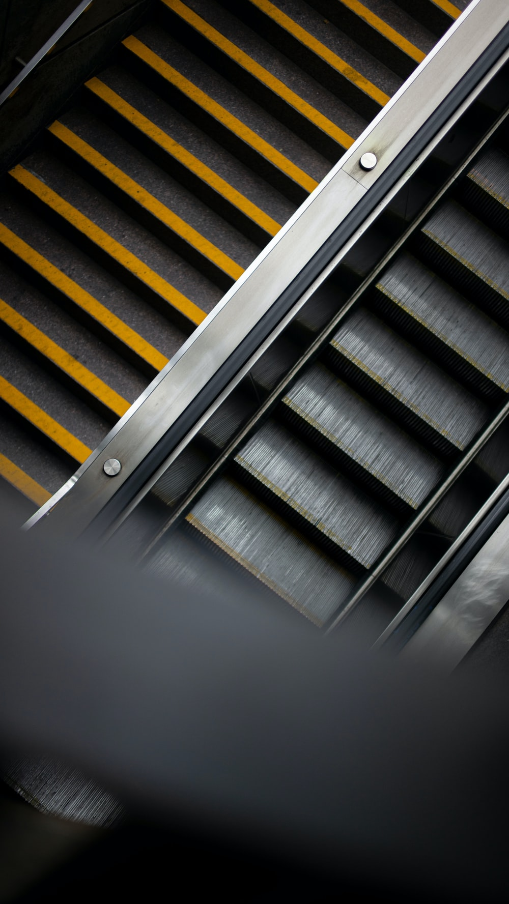 gray and yellow staircase in close up photography
