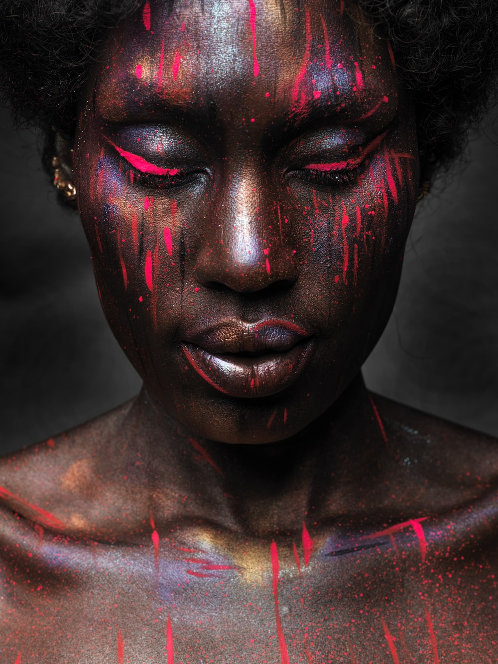 woman with red and black face paint