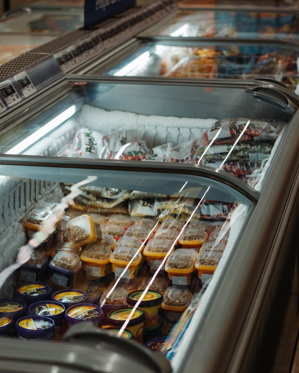 assorted food in silver commercial refrigerator