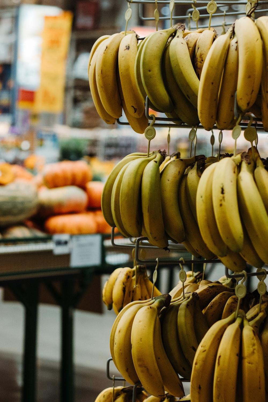 yellow banana fruit on black metal rack