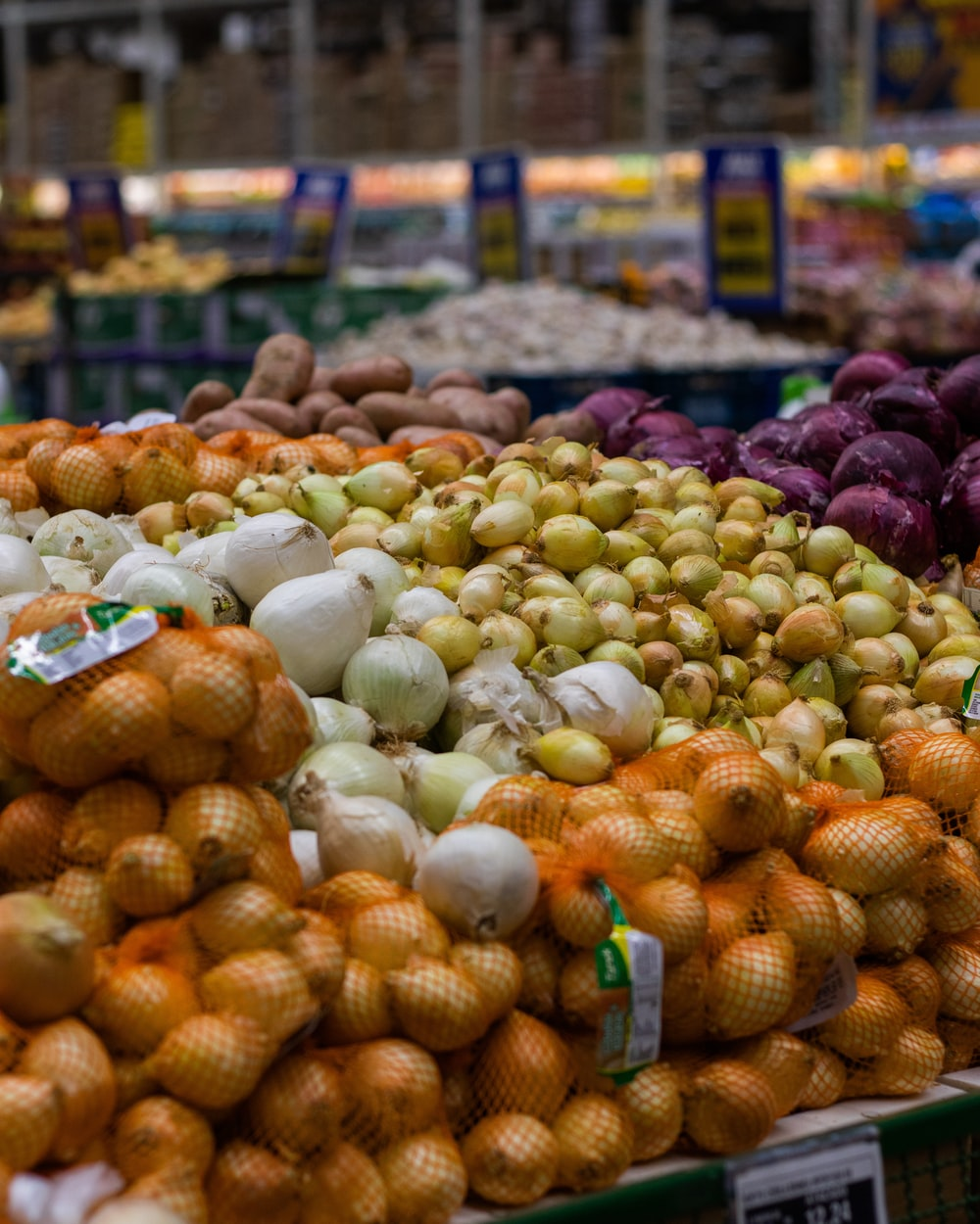 white garlic on brown woven basket