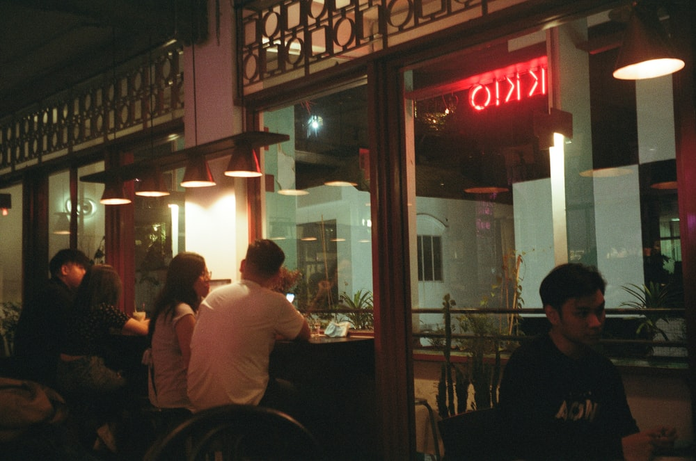 people sitting on chair in restaurant