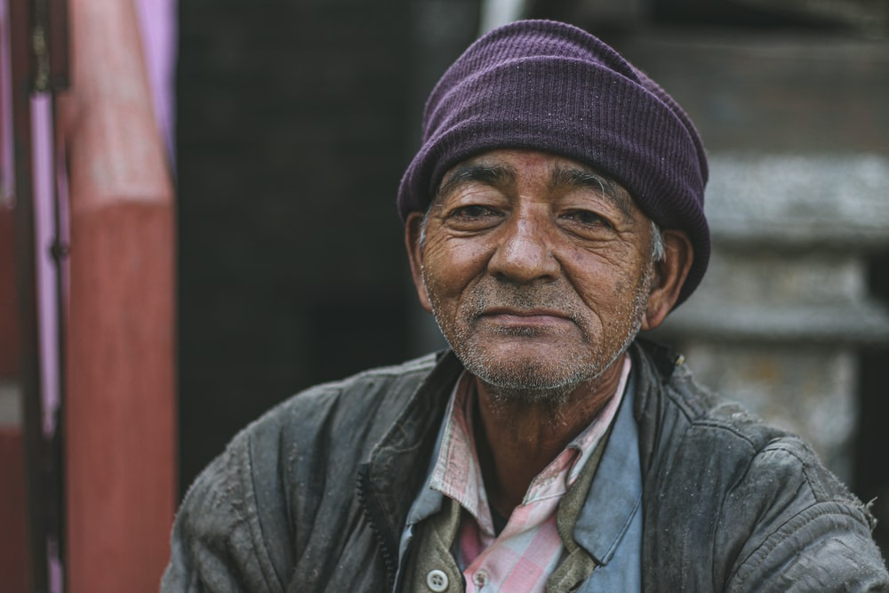 man in gray jacket and black knit cap