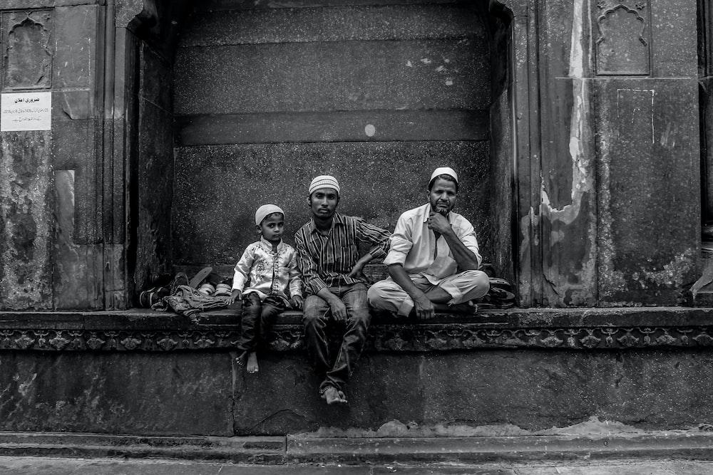 2 men sitting on concrete bench