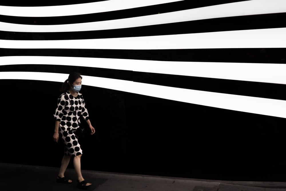 woman in black and white dress standing on the hallway