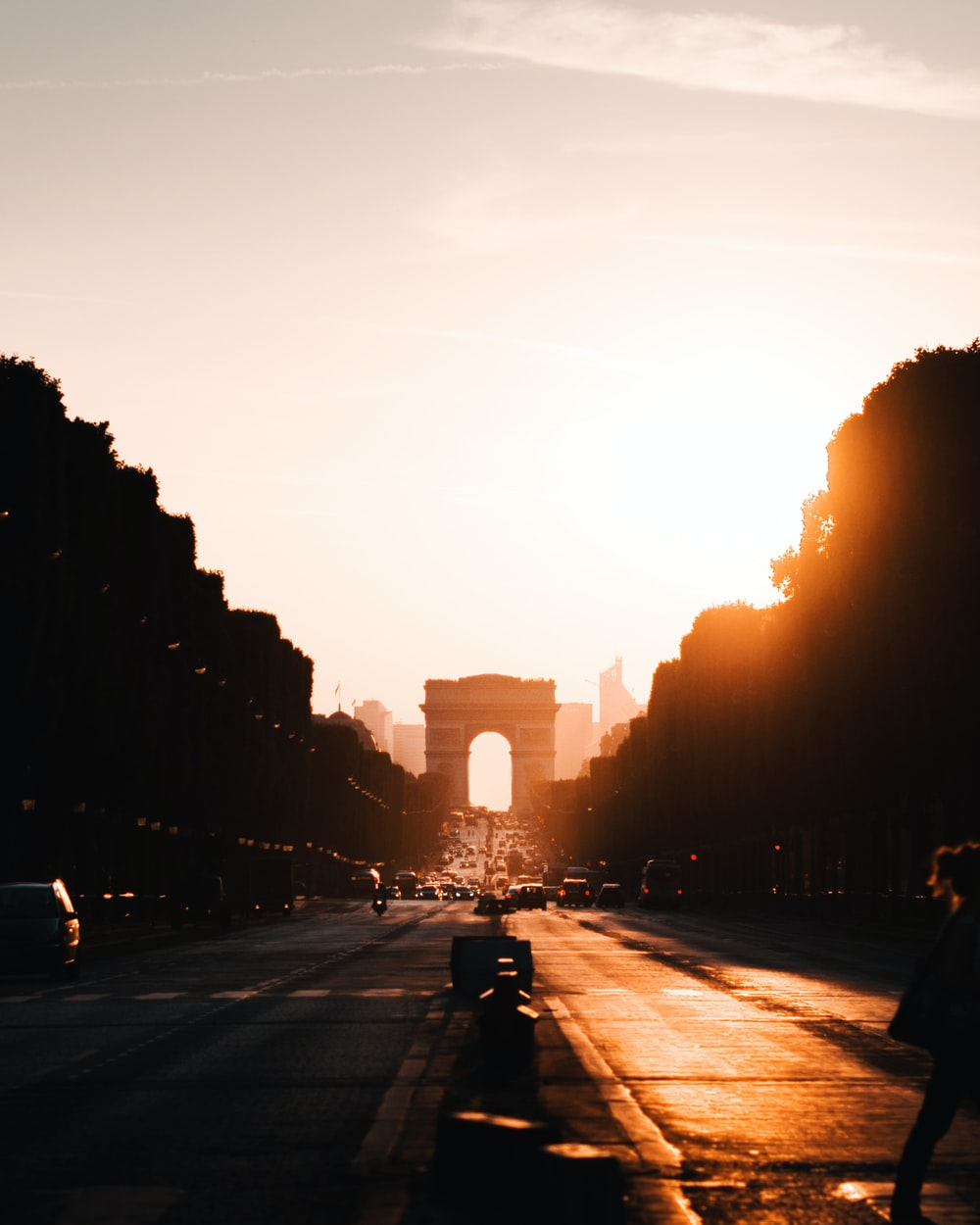 people walking on road during sunset