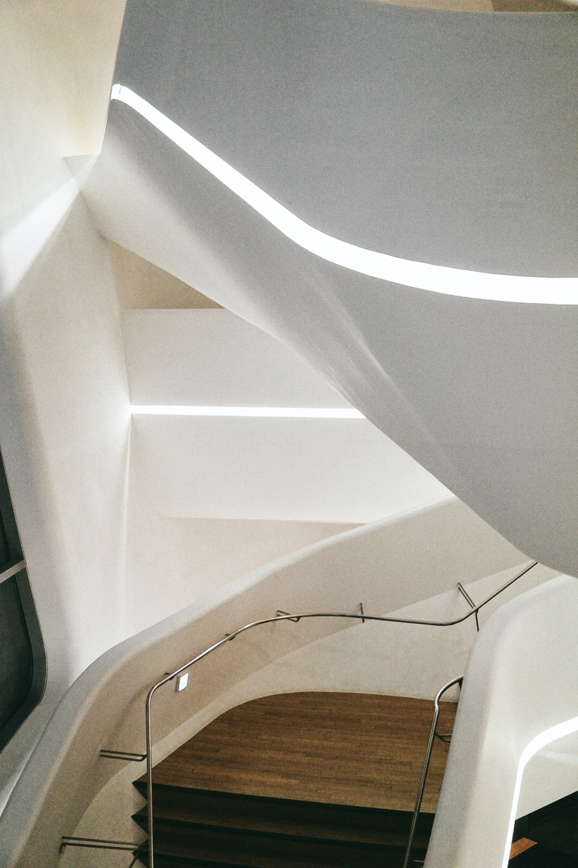 white ceramic toilet bowl near white wall