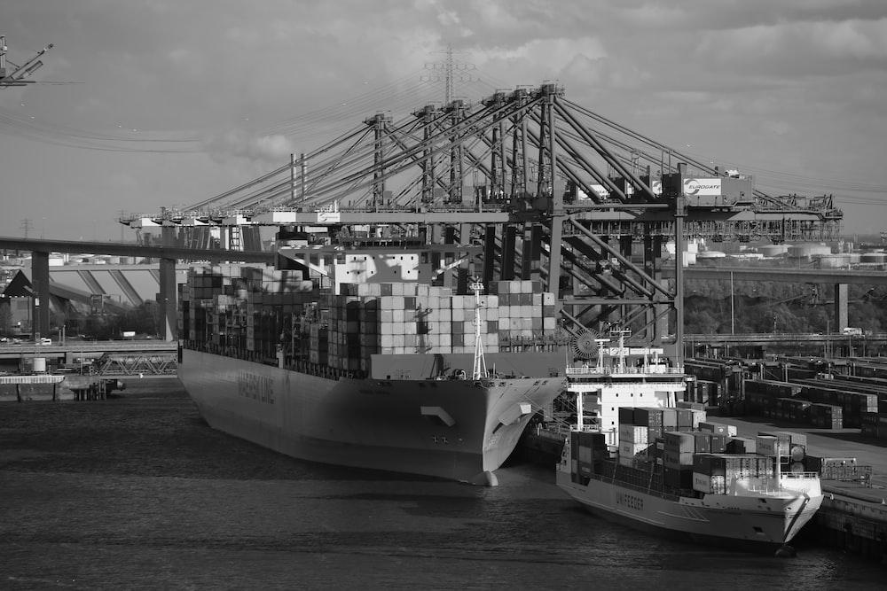 grayscale photo of cargo ship