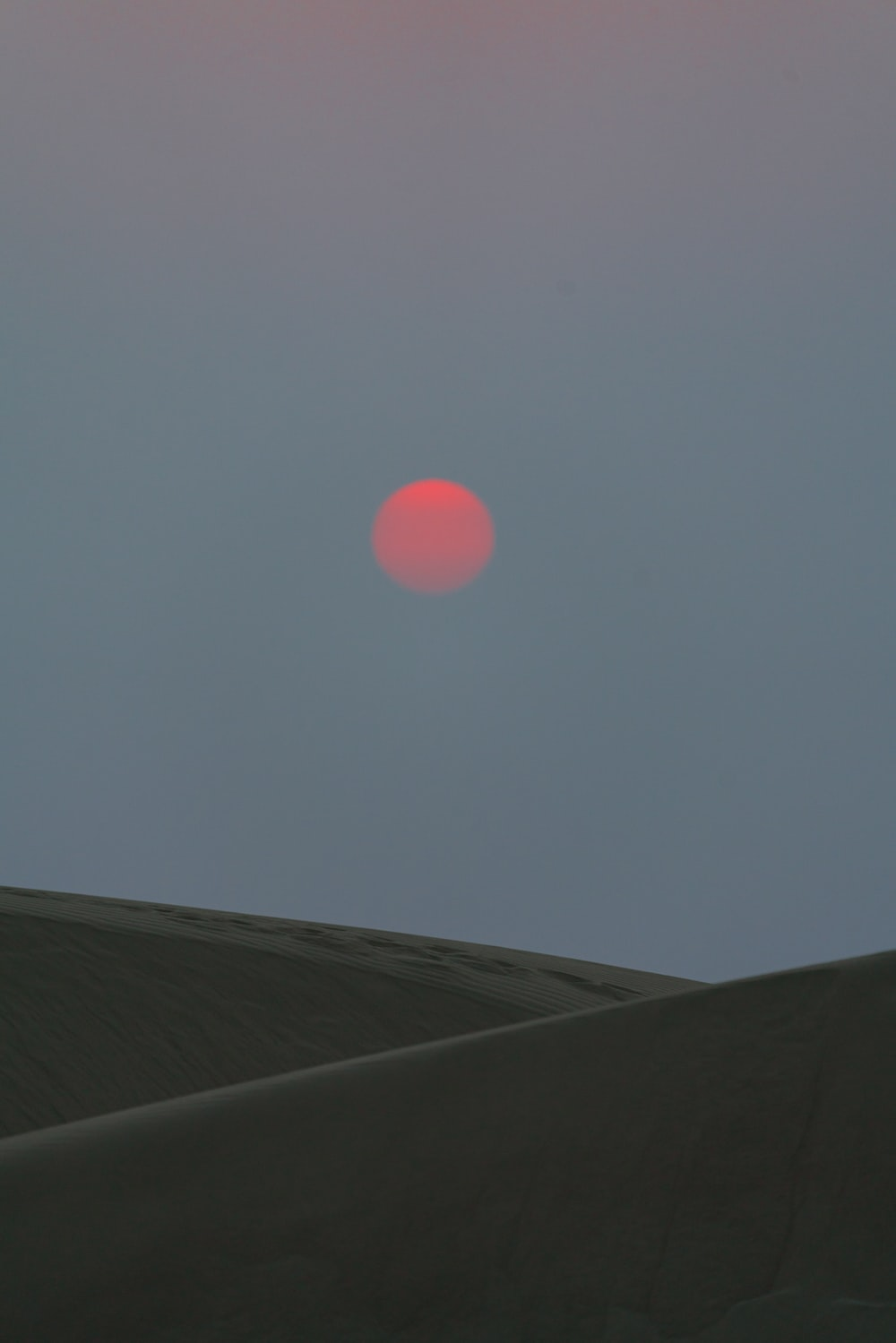 red moon on gray sky