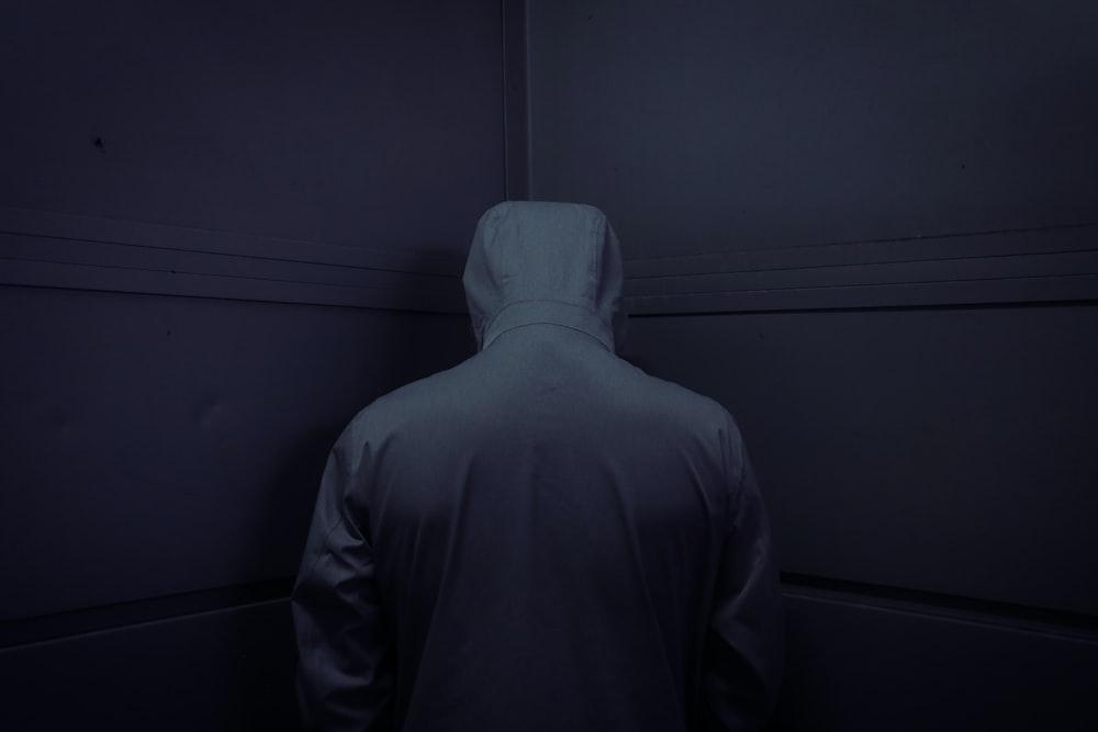 man in gray hoodie standing