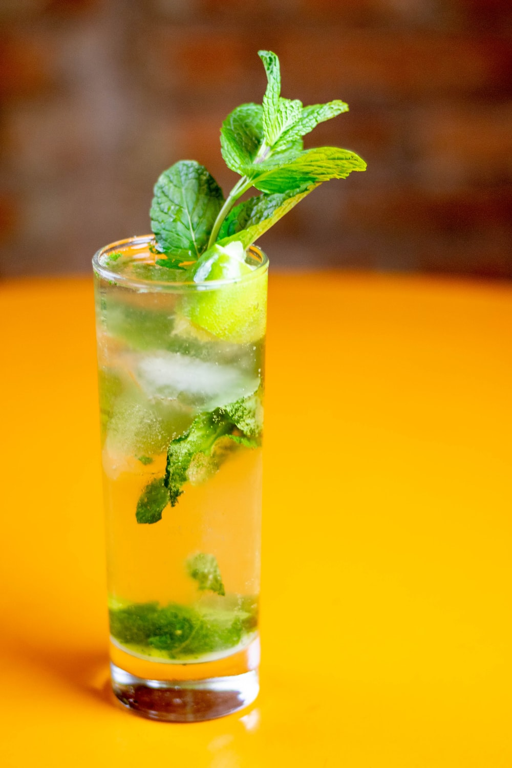 green leaf in clear drinking glass