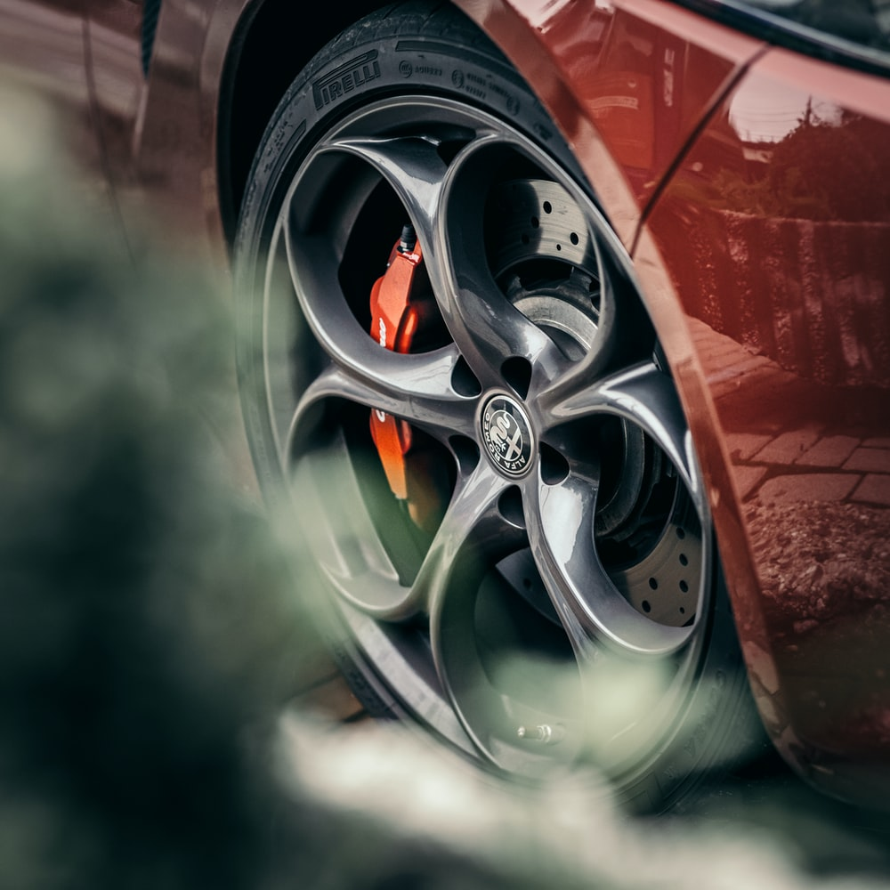 red and silver car wheel
