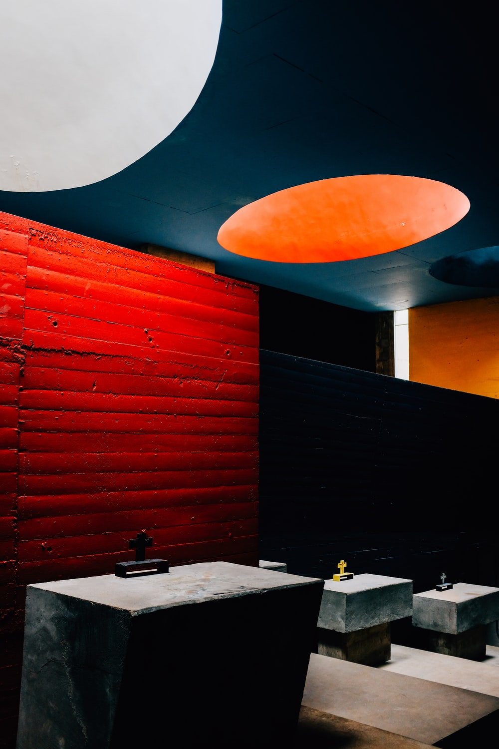 red and black wall with white ceramic sink