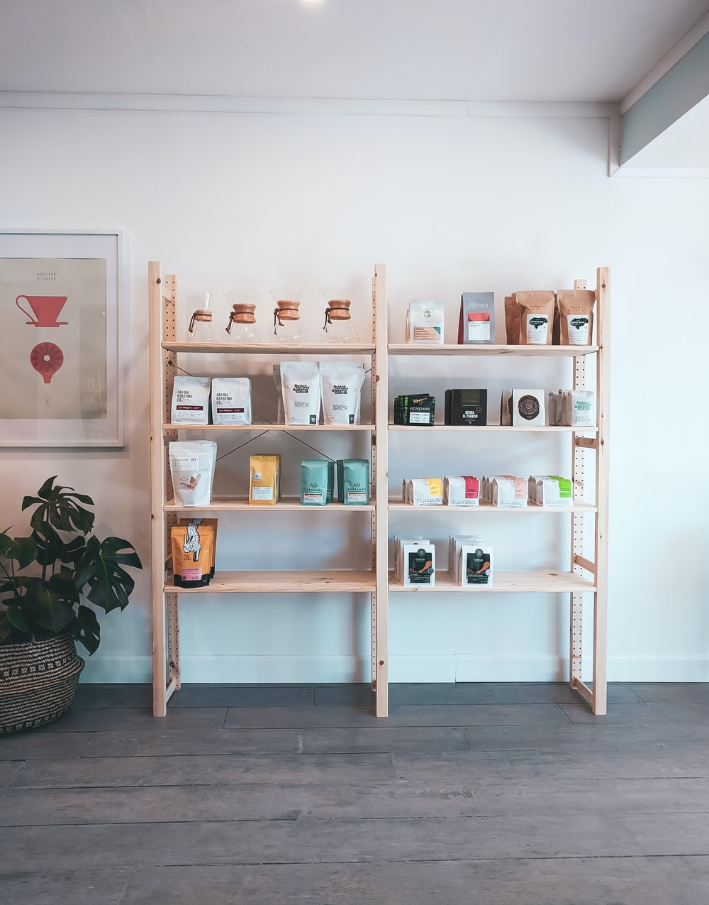 brown wooden shelf with books and figurines