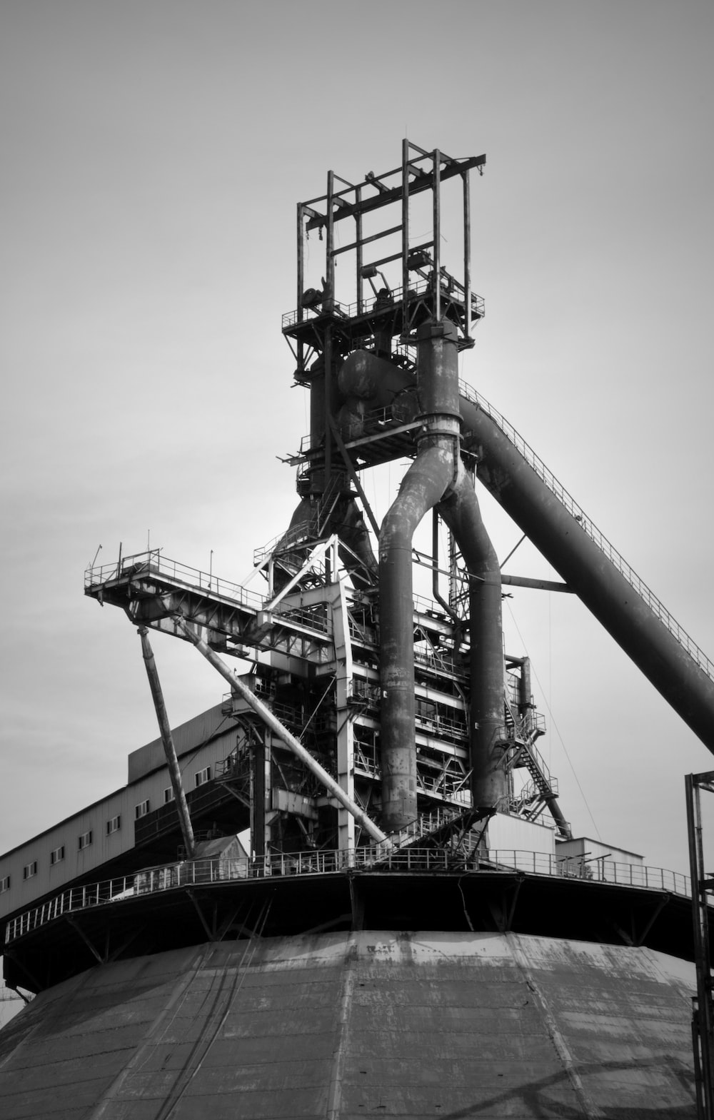 grayscale photo of metal tower