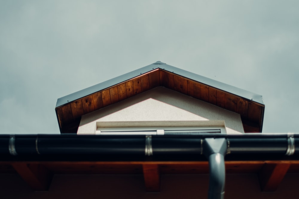 brown wooden roof under white sky during daytime