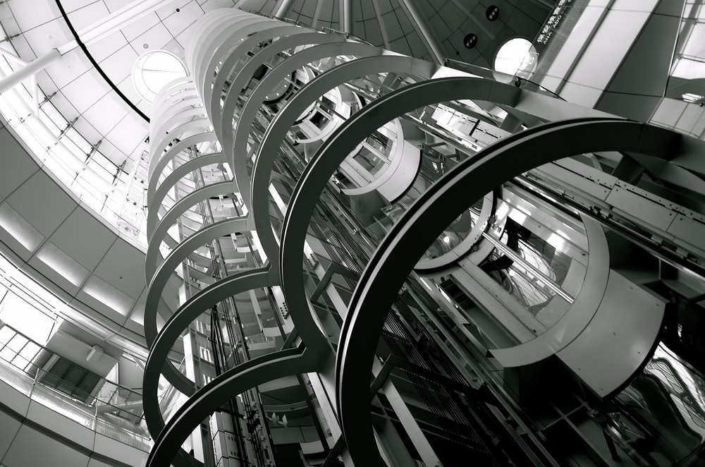 white metal spiral staircase inside building