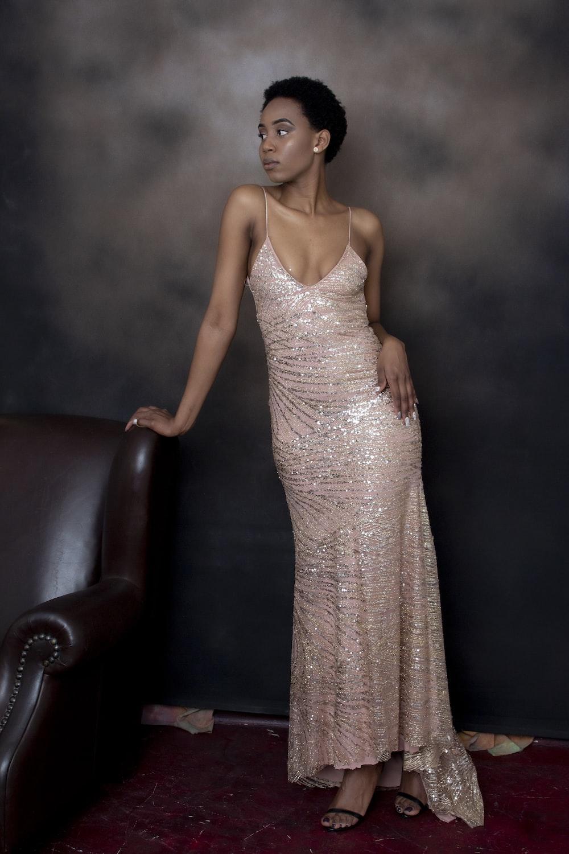 woman in silver spaghetti strap dress