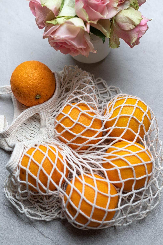 orange fruit on white knit textile