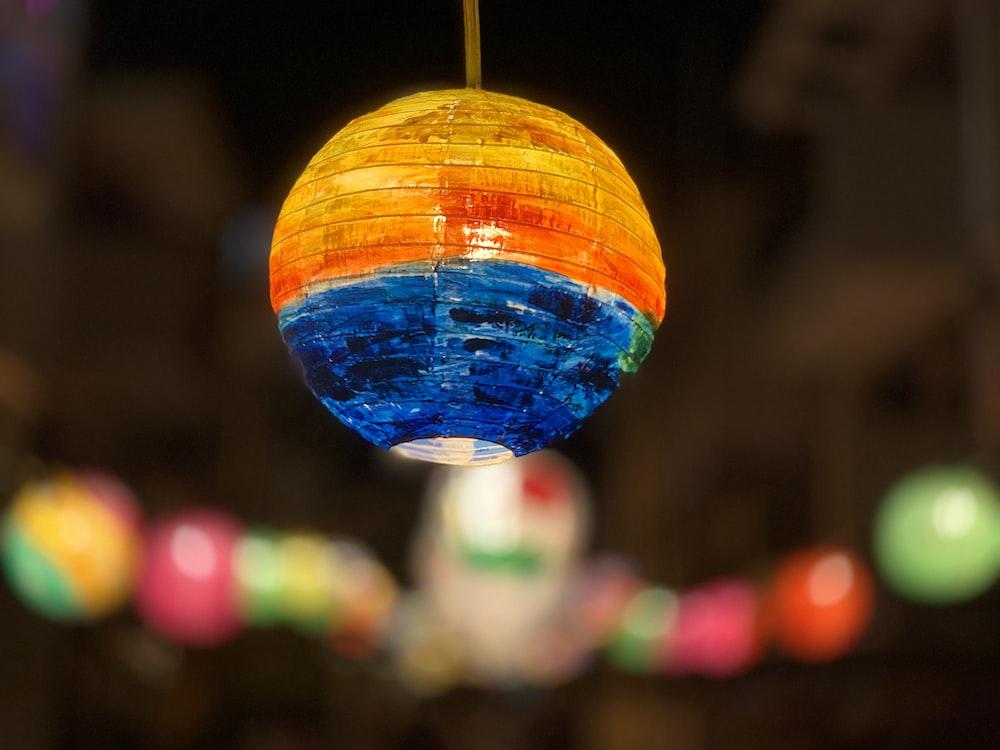 orange and blue round pendant lamp