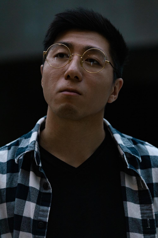 man in black and white checkered dress shirt wearing eyeglasses