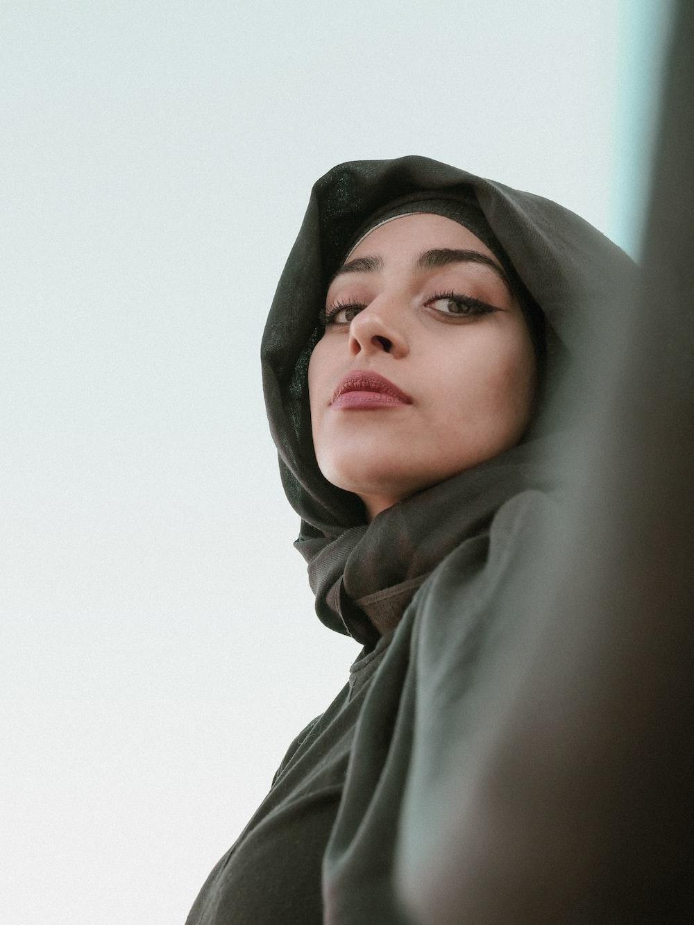 woman in gray hijab taking selfie