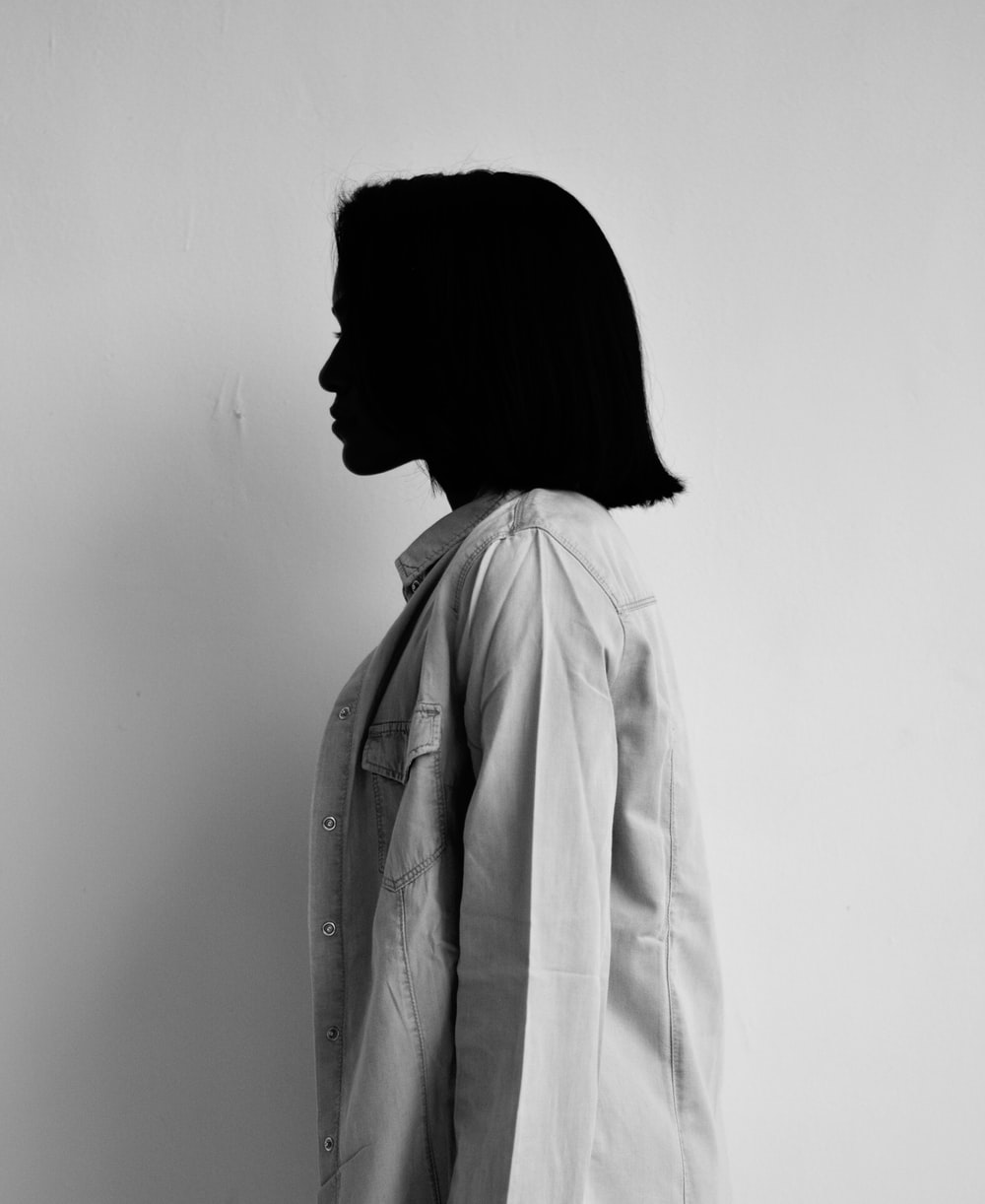 woman in white coat standing