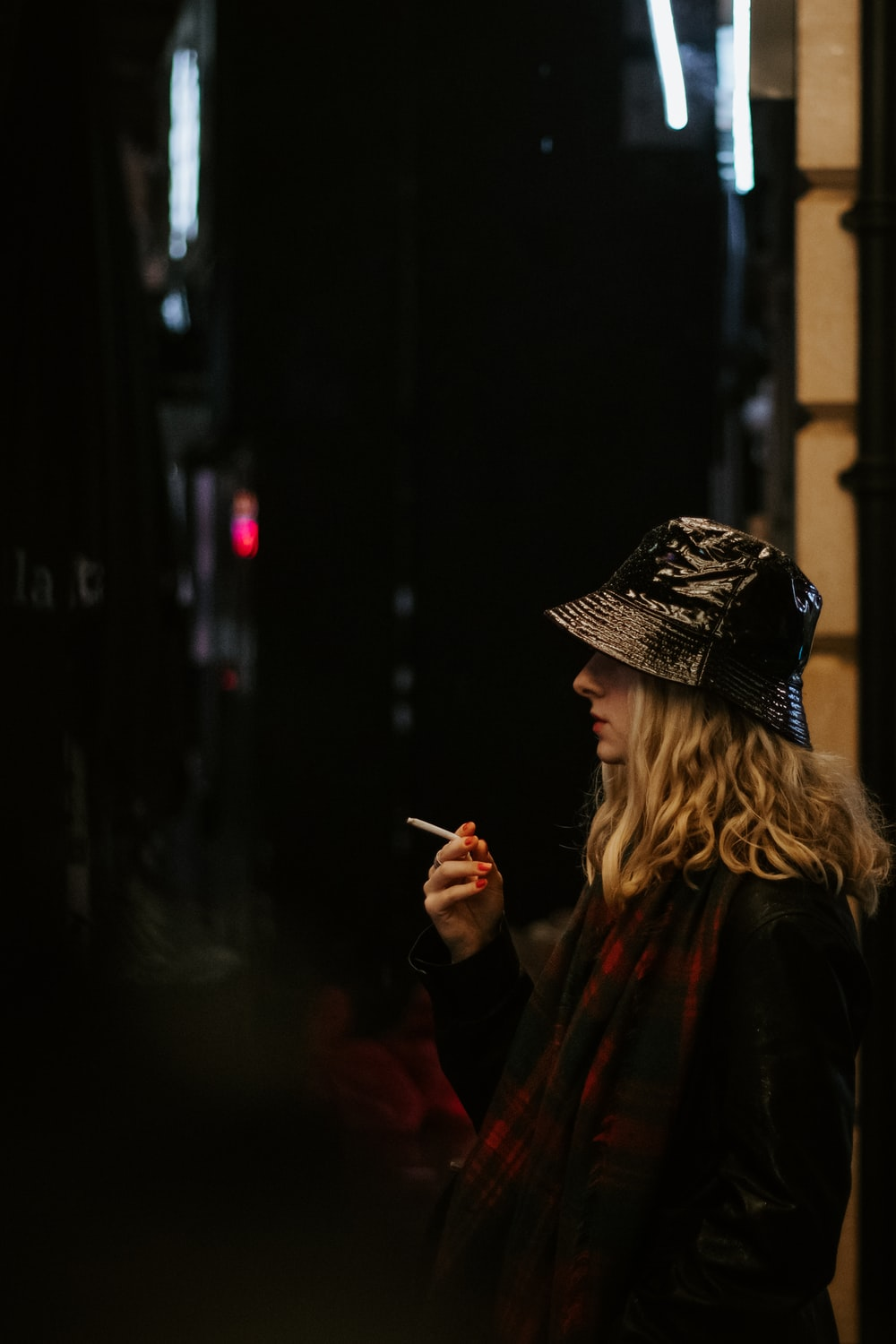 woman in black knit cap smoking cigarette