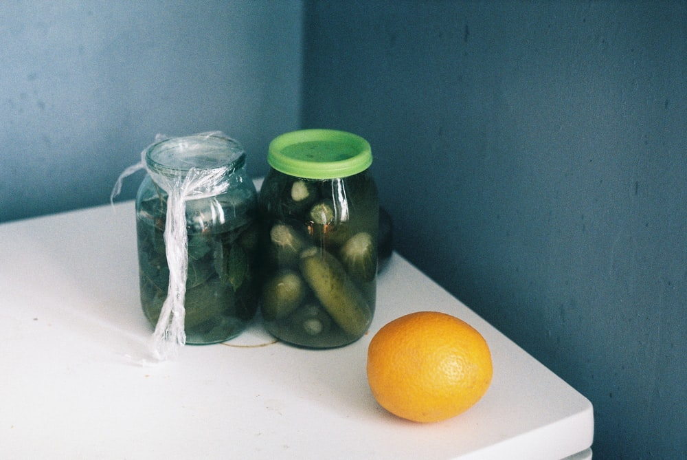 clear glass jar with green lid