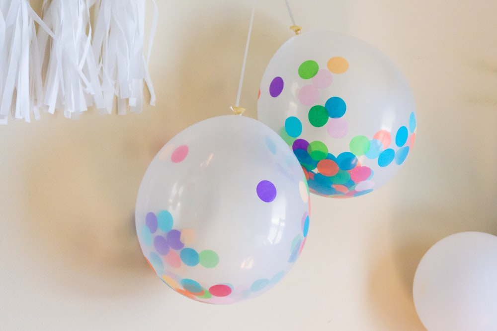 blue pink and yellow balloons
