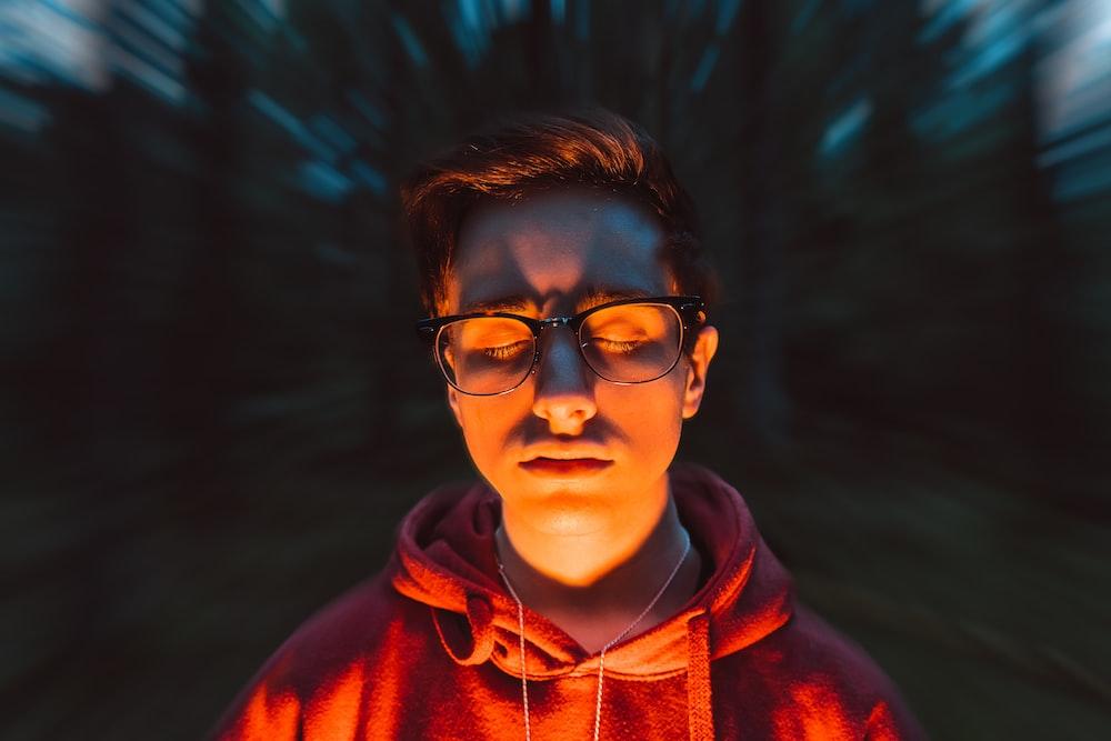 boy in red hoodie wearing black framed eyeglasses