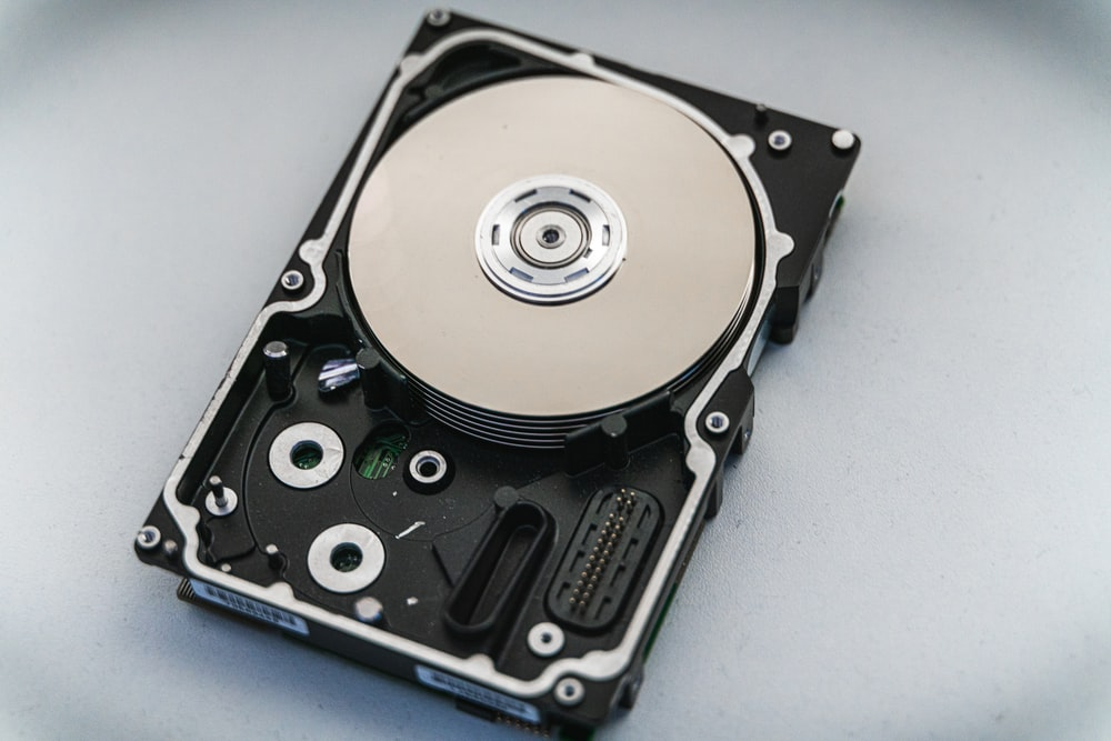 silver and black hard disk drive