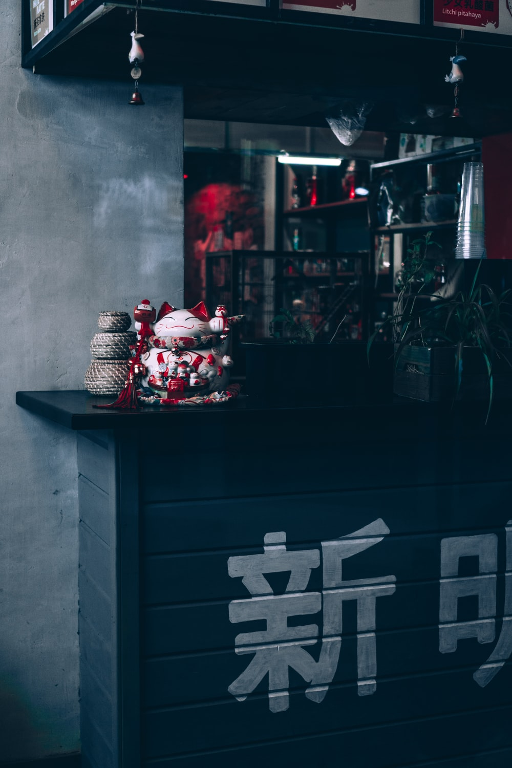 red and white gift boxes on black wooden cabinet