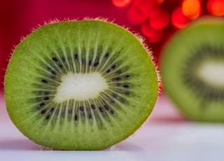 sliced green fruit on white table