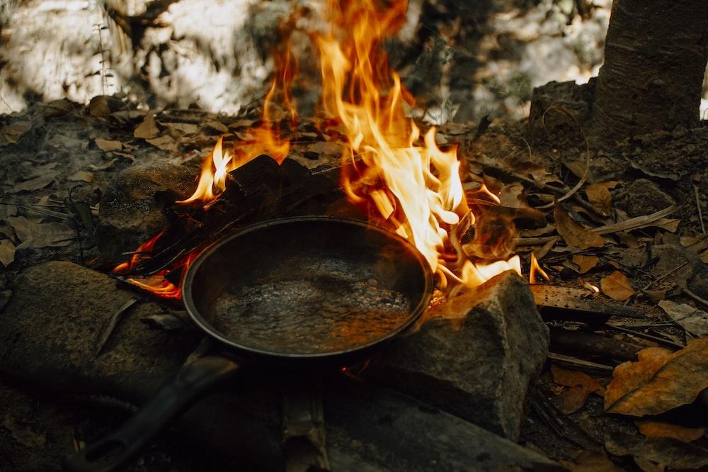 black frying pan on fire