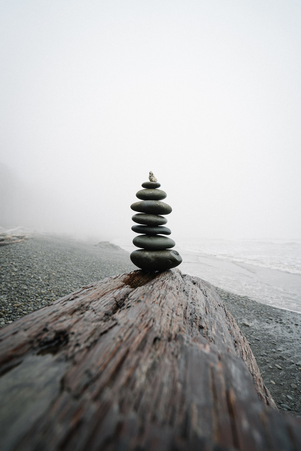 stack of stones on a foggy weather