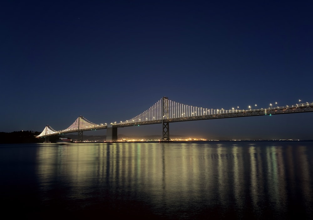 bridge over water during night time