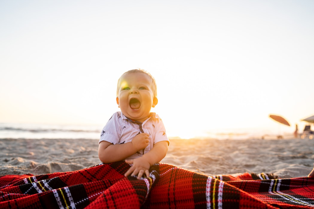 baby with picnic blanket