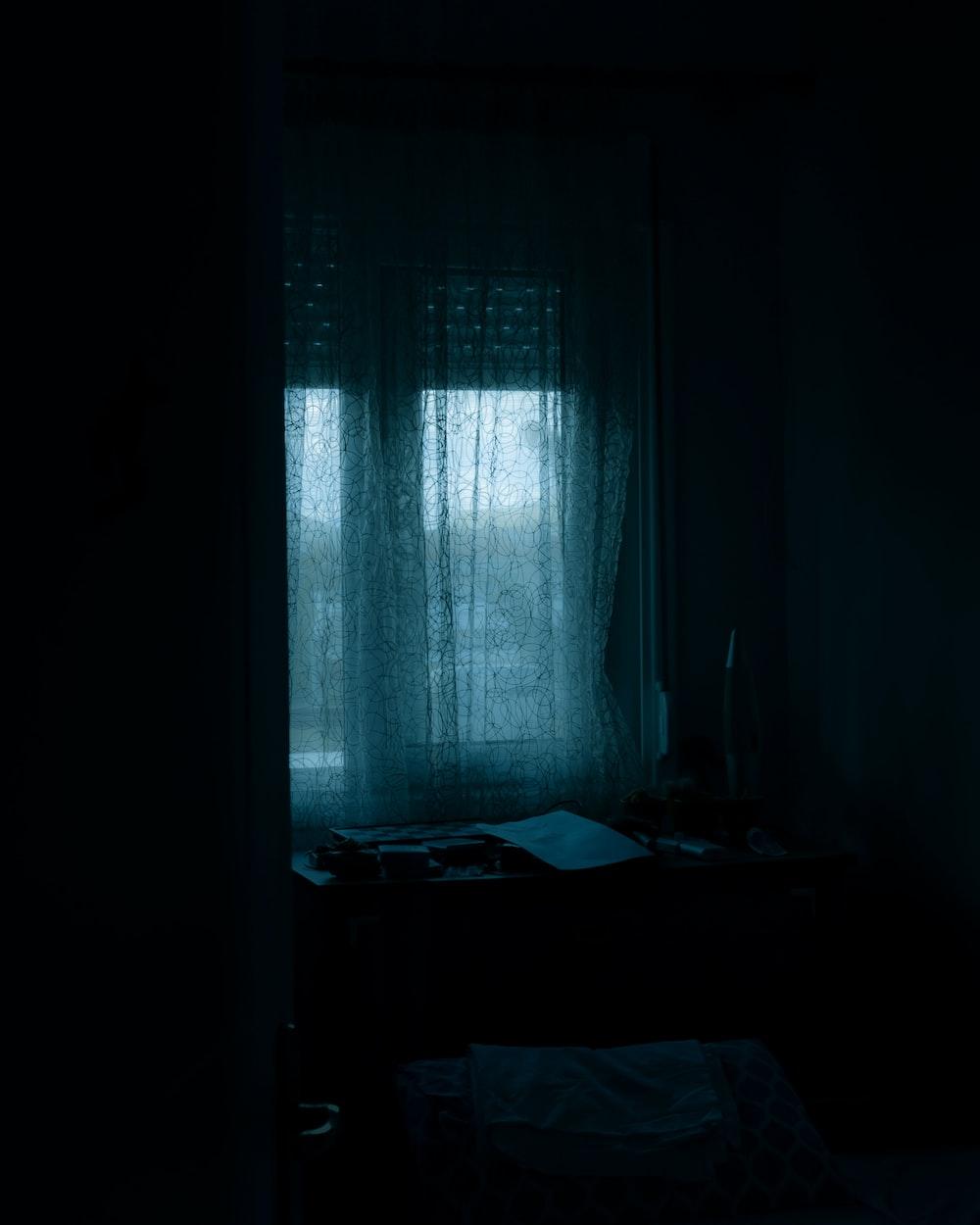 white window curtain on window
